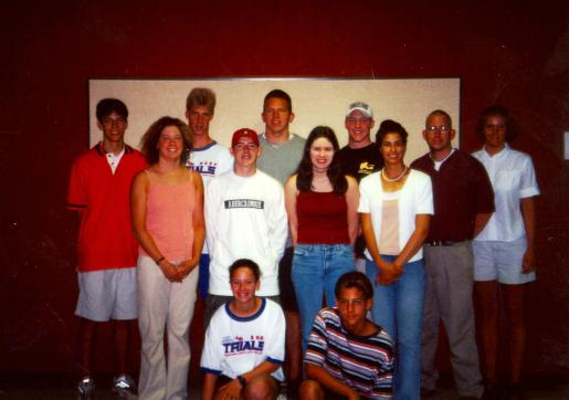 The 2001 Deaf World Games Swim team (from back to front; L-R):  Dale Parker, Jake Hammack, Mark Gresholdt, Chris Nelan, Greg Reese, Lora Widman, Megan Ackerman, Matt Jenkins, Stephanie Danner, Seda Ozdemir, Caitlin Morgan, Jonathan Tikhonoff